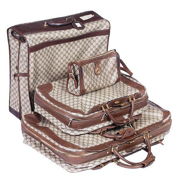 Gucci, a set of luggage, with brown leather trim