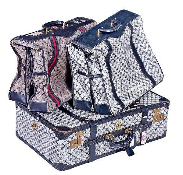 Gucci, a three piece luggage set, with blue