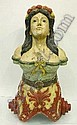 A decorative 19th century style polychrome carved hardwood ship's figurehead, modelled as a buxom young girl with floral garland in her hair, with leafy carved scroll term base, 114cm high.