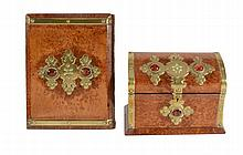 A Victorian burr walnut and brass mounted desk set comprising stationery...