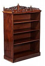 A Victorian figured walnut open bookcase , circa 1860