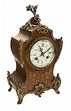 A French marquetry mantel clock , late 19th century