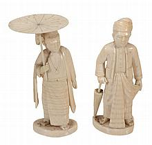Two Indian Ivory Figures, each carved to depict a standing man dress in...