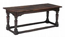 A Charles II oak refectory table, circa 1680 , with cleated five plank top