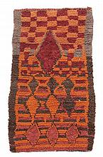 A Moroccan rug, approximately 170cm x 86cm