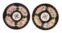 A pair of Coalport bone china blue and ivory-ground plates, circa 1820