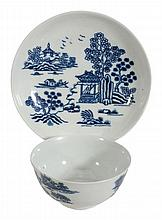 A Worcester blue and white printed large tea bowl and saucer, circa 1758