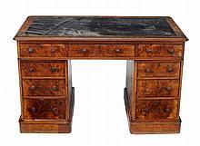 A Victorian burr walnut pedestal desk, circa 1880