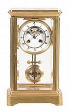 A French brass four-glass mantel clock, L