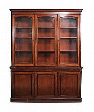 A mahogany three door library bookcase , first half 19th century