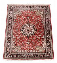 A Persian silk carpet, approximately 310 x 199cm