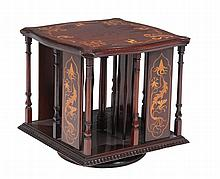 An Arts and Crafts mahogany and inlaid table top revolving bookcase