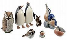 Seven Royal Copenhagen porcelain animals: two bird groups, an owl, a hare