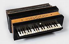 A piano accordion, probably French, circa 1850, the three octave keyboard
