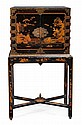 A Chinese black lacquer and gilt decorated cabinet