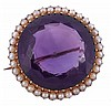 A late Victorian amethyst and half pearl brooch,