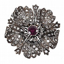 A late 19th century diamond and garnet flower