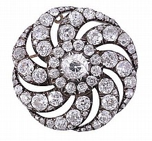 A late Victorian diamond whorl brooch, circa 1880,