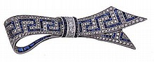 An early 20th century sapphire and diamond bow