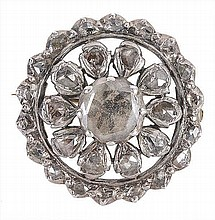A diamond cluster brooch, the circular brooch set