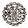 A diamond cluster brooch, the circular brooch set