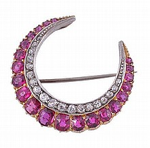 A late Victorian ruby and diamond crescent brooch,