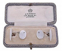 A pair of early 20th century diamond cufflinks,
