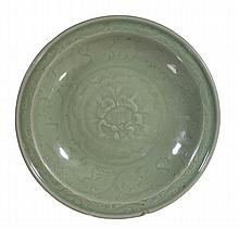A Longquan celadon dish, Ming, moulded with a