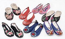 A collection of seven Chinese silk slippers, 19th