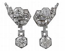 A pair of diamond drop earrings, circa 1950, of geometric design