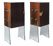 A pair of macassar ebony and glass cabinets, circa 1960