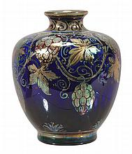 A Pilkington's Royal Lancastrian squat lustre vase, decorated by Richard Joyce