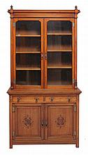 An Arts and Crafts walnut bookcase , late 19th/ early 20th century