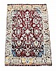 An Agra rug, the maroon field decorating with