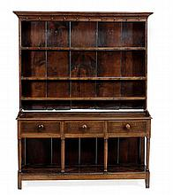 A George III oak dresser, circa 1780, with an open