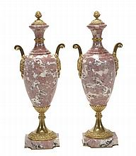 A pair of gilt metal mounted mottled pink and