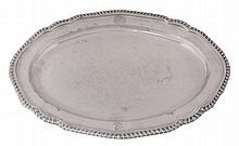 A George III silver shaped oval meat plate by John Wakelin & William Taylor