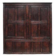 An oak panelled cupboard, 17th century and later