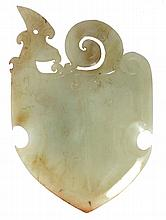 A Chinese archaistic celadon and russet jade axe head , with phoenix surmount