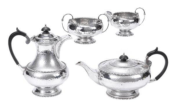 A silver circular four piece tea service by Walker