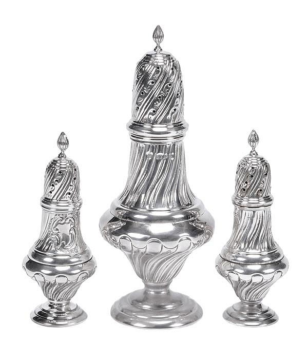A set of three silver ogee baluster casters,