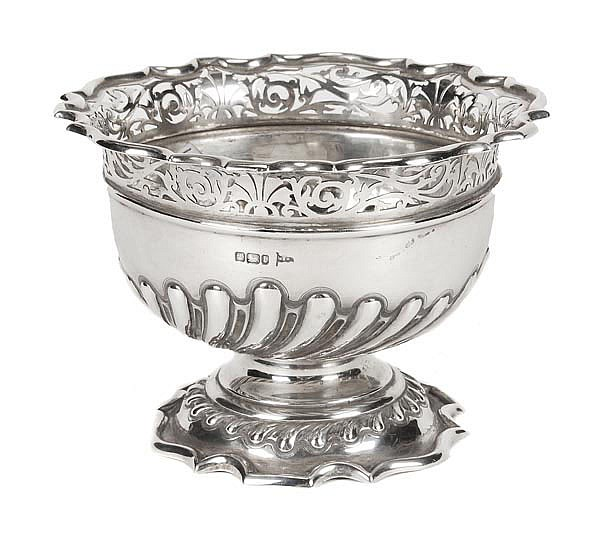 An Edwardian silver shaped circular pedestal bowl