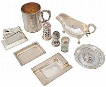 A collection of silver items, to include: a shaped oval sauce boat by Barker...