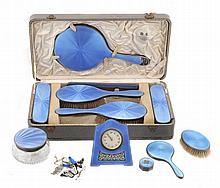 A cased silver and blue enamel mounted six piece dressing table set by...