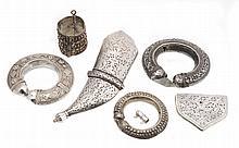 A silver coloured Khanjar sheath mount, with pierced foliate scroll decoration