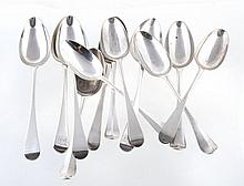 A collection of silver Hanoverian and Old English pattern table spoons