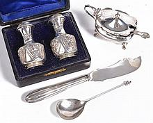 A pair of late Victorian embossed silver pepperettes by Henry Williamson Ltd