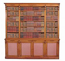 A companion pair of Victorian satinwood and marquetry library bookcases