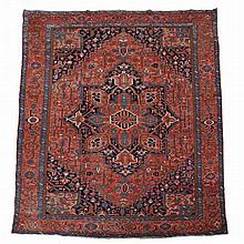 A Serapi carpet , decorated throughout with abstract foliate motifs