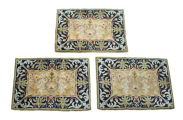 A set of three Arts and Crafts hand knotted